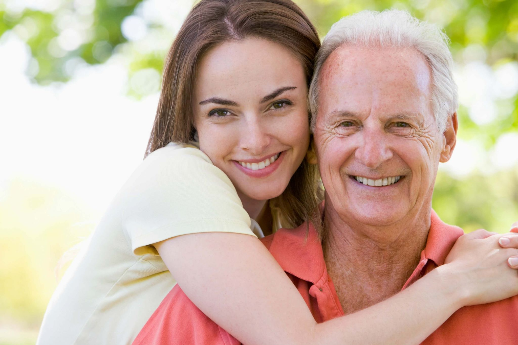 spoil your dad rotten this father's day - woman hugging her dad