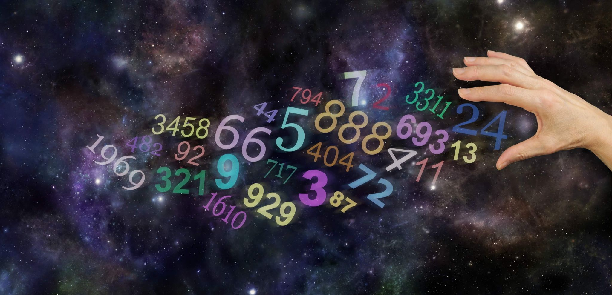 numerology - multiple numbers on a starry background floating towards an outstretched hand