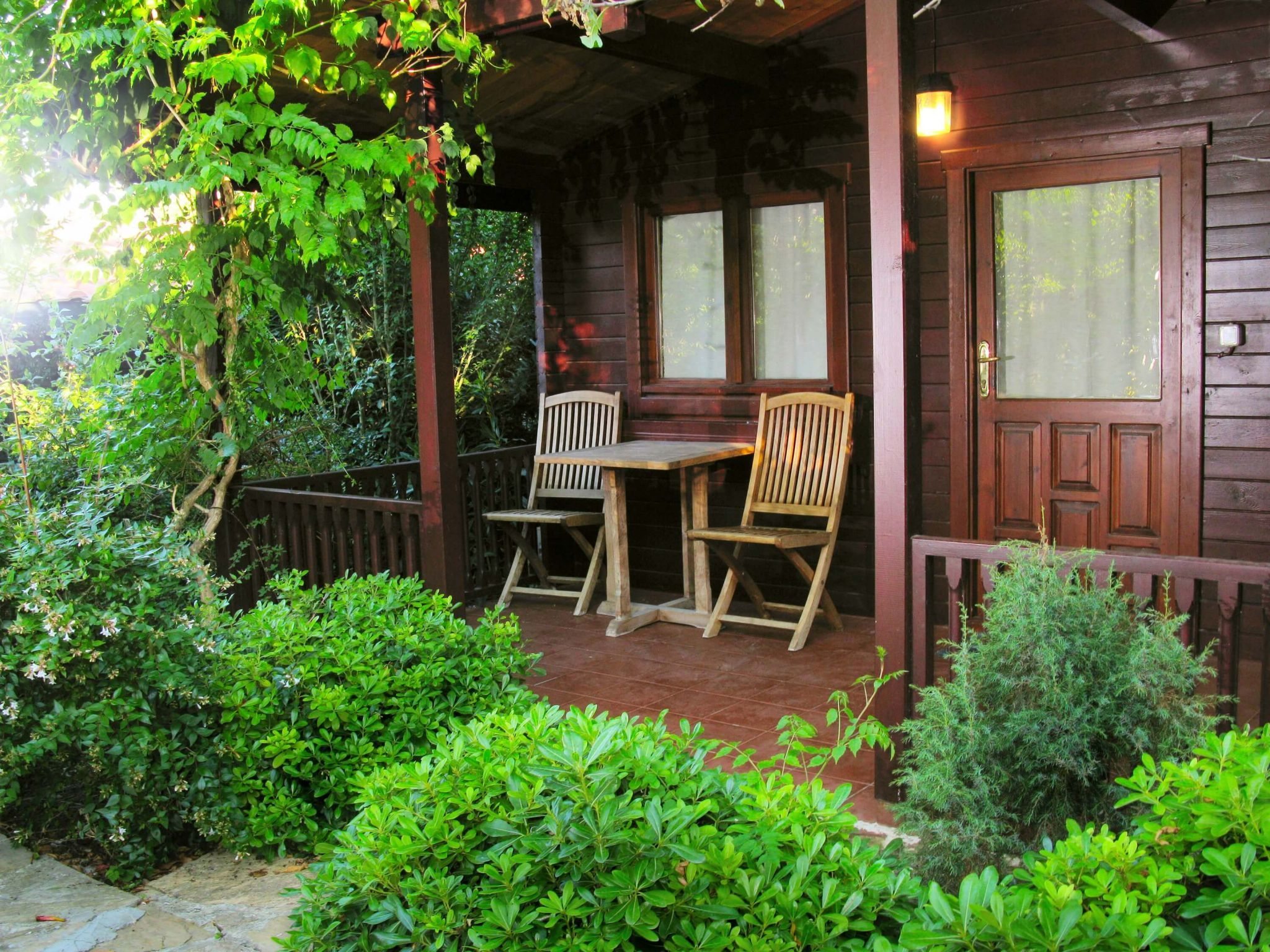 How can you use your summerhouse? - garden chairs outside summerhouse