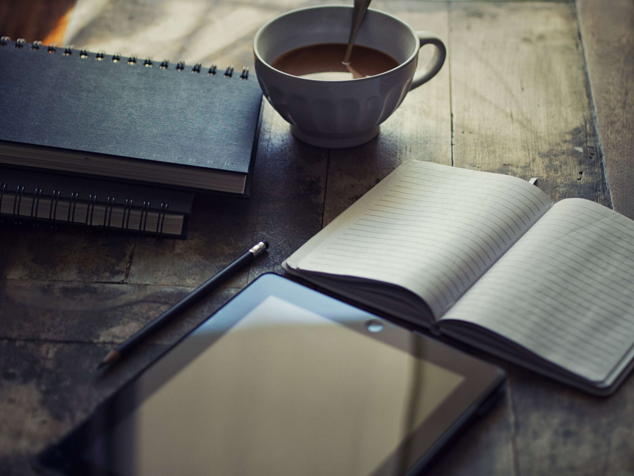 blogging as a business - cup of coffee, books and a notebook