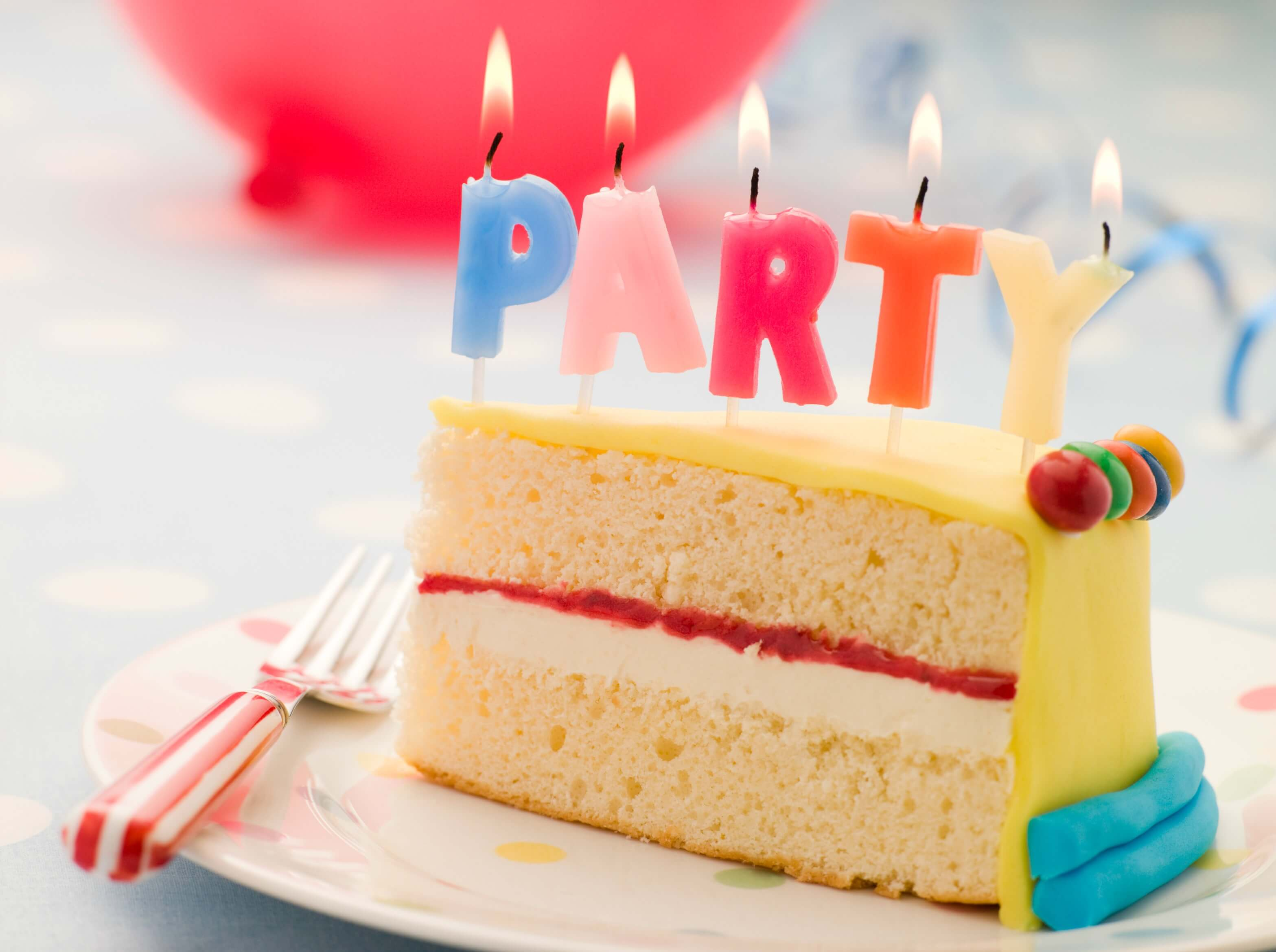 birthday gifts for classmates - party cake with candles spelling out the word party