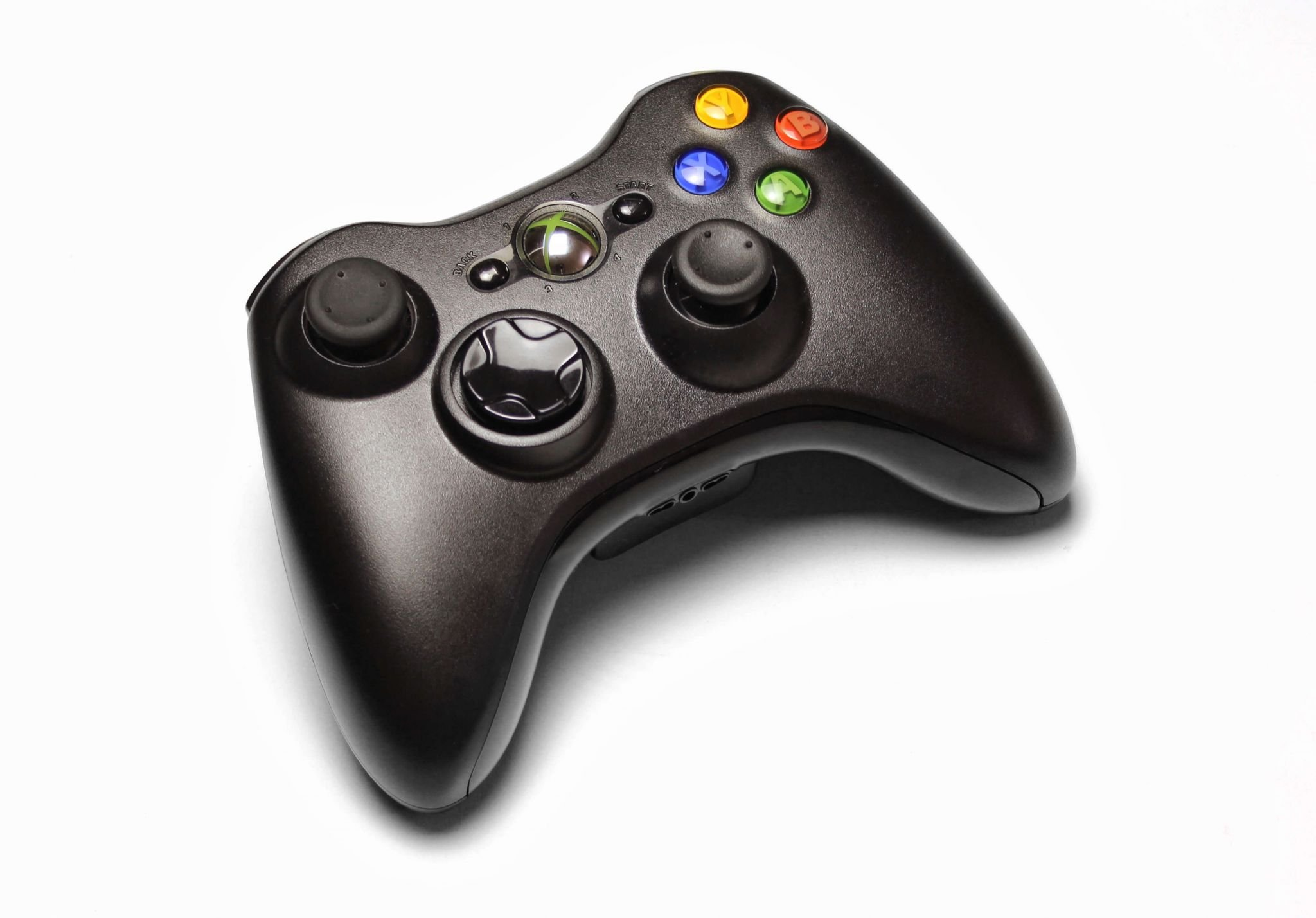 dangers of online gaming - black Xbox controller