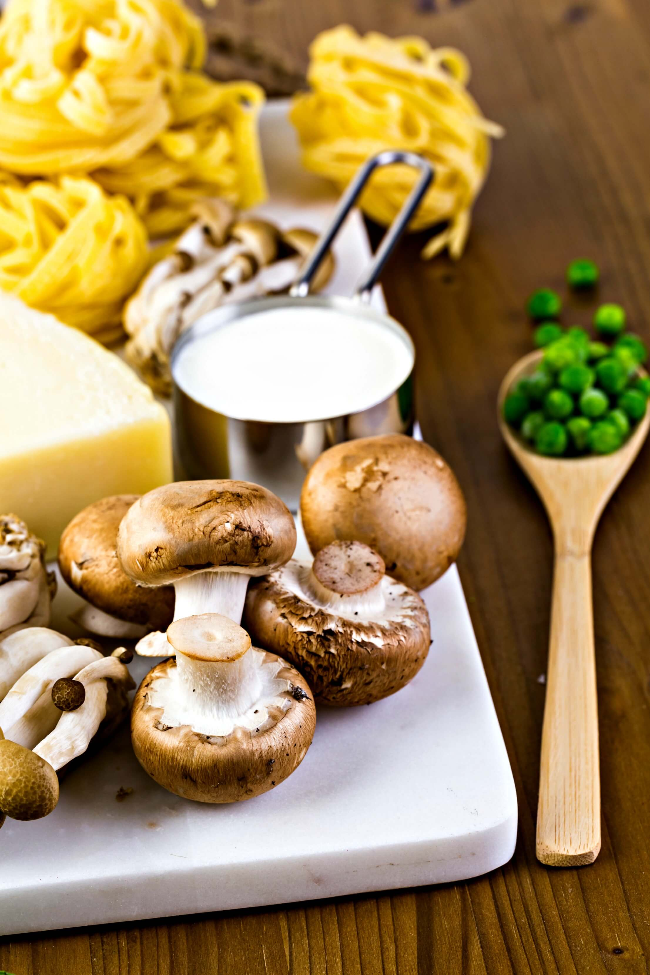 HelloFresh recipes - pasta, fees, cheese and mushrooms ready to be assembled into a dish