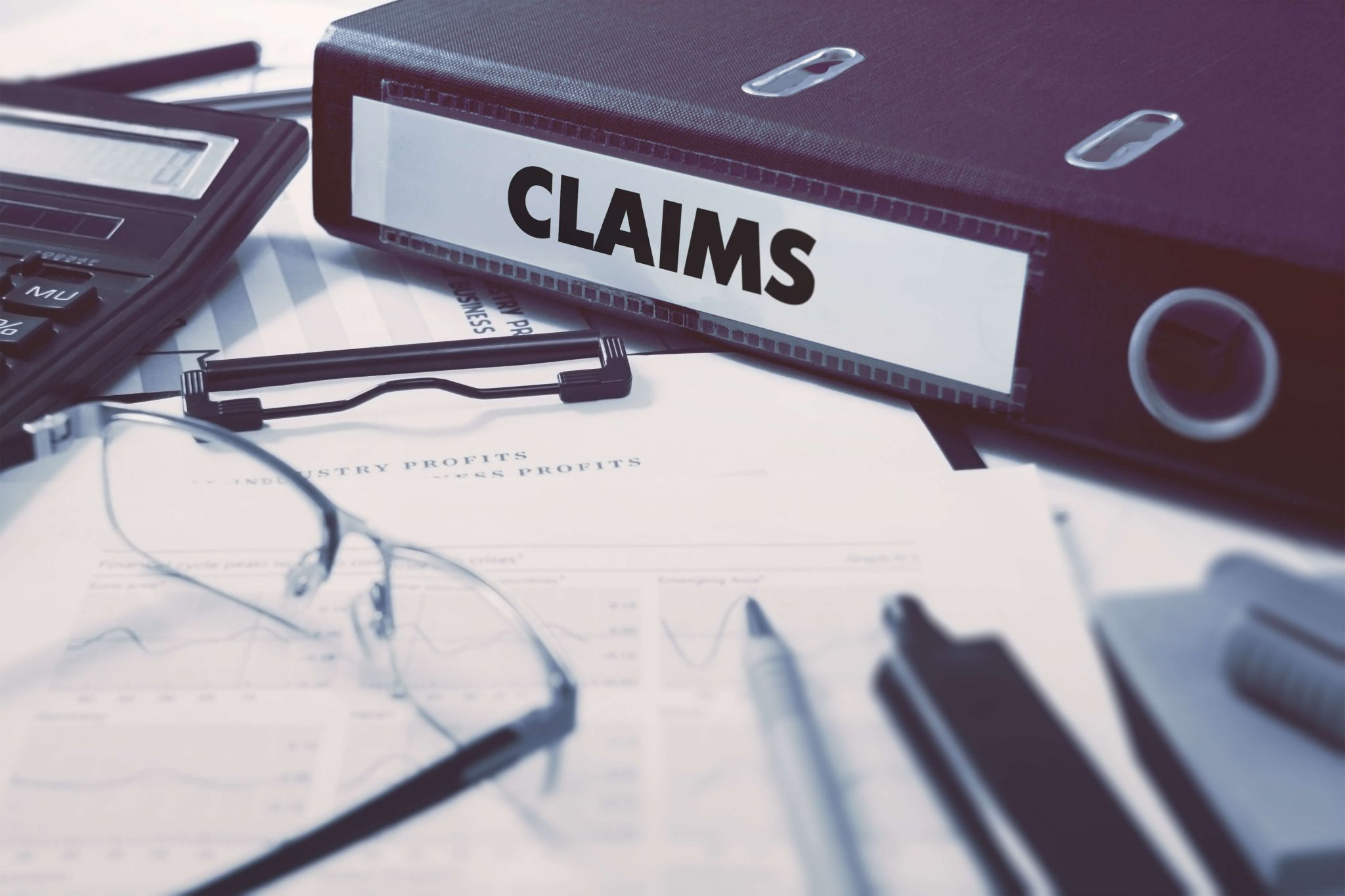 Plevin & PPI Claims - claims form folder and glasses on desk
