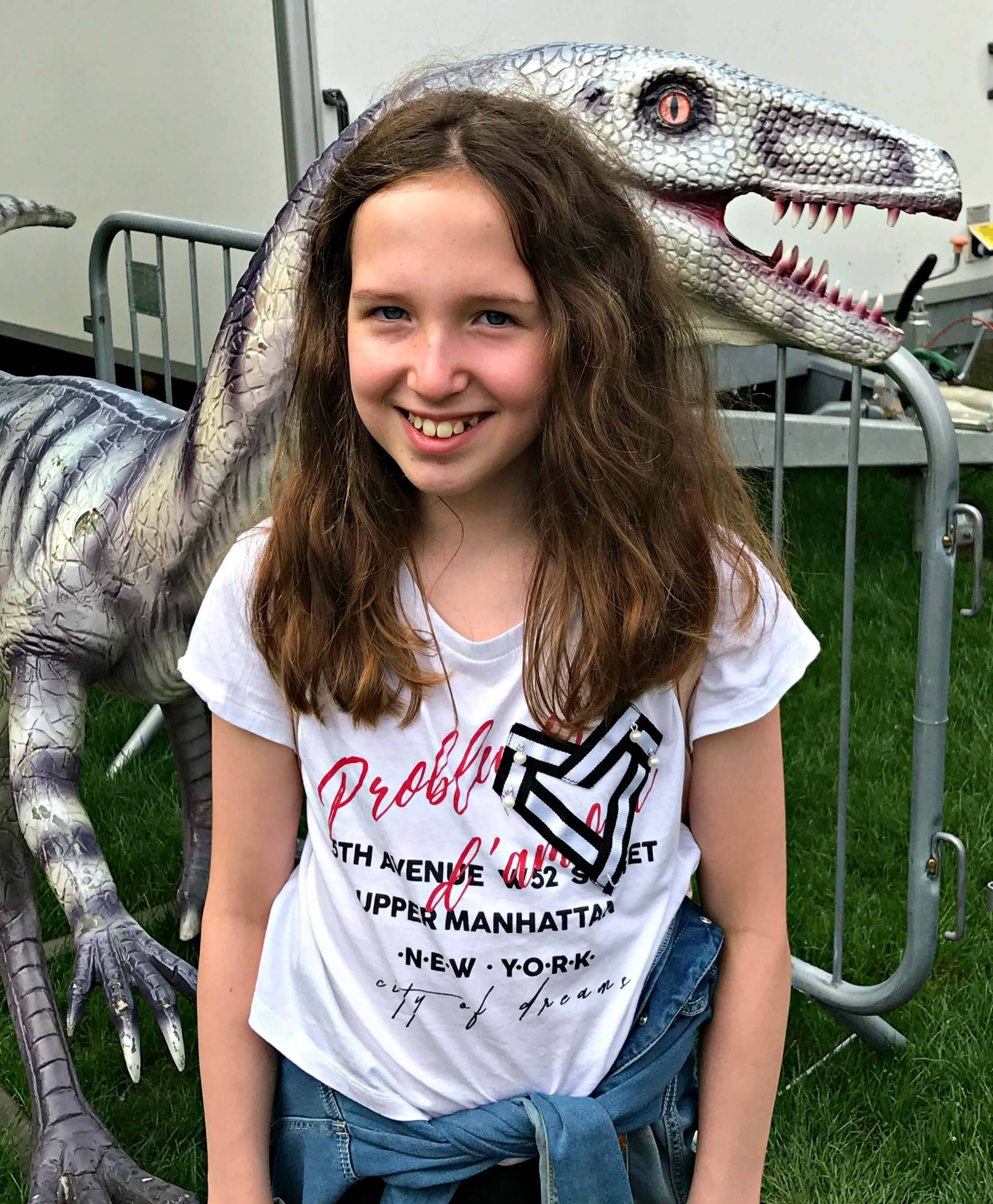 Jurassic Kingdom - Caitlin in front of a small dinosaur