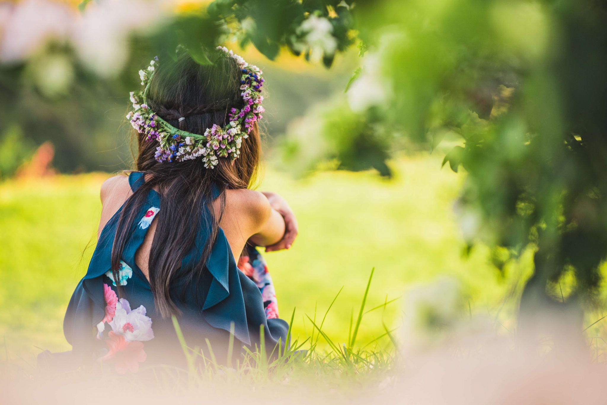 Summer healthcare giveaway - woman in a meadow wearing a head band of flowers