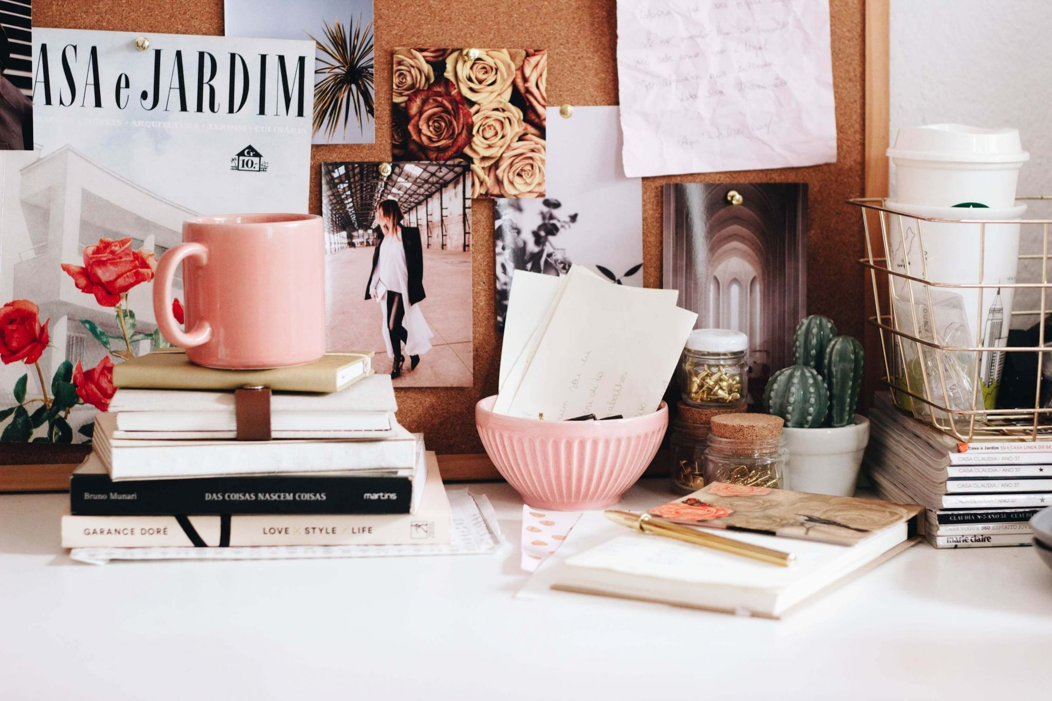 free and bargain books - a desk scene with pink mug, pink bowl and a selection of books by a notice board