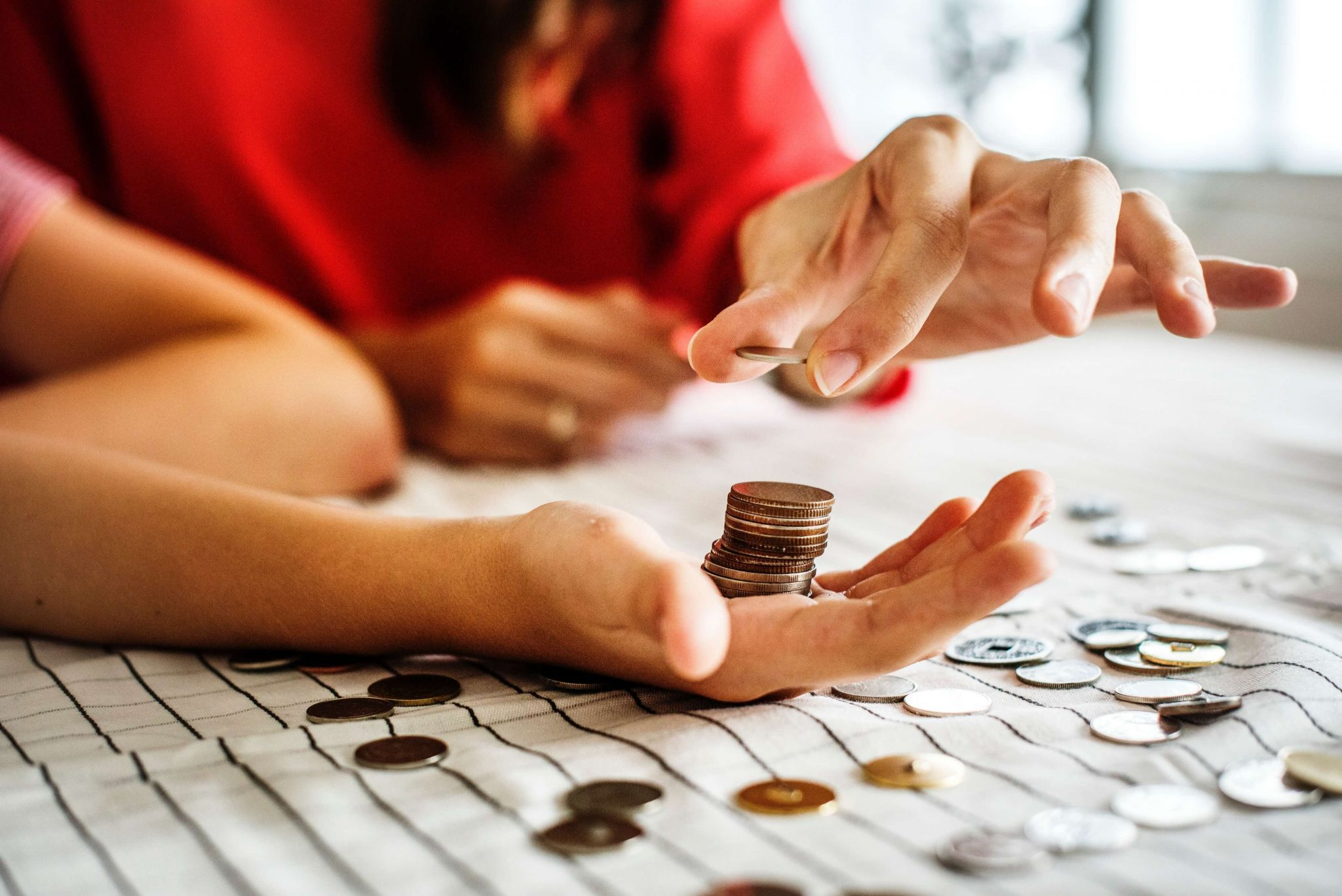 Financial safety net - man and woman counting coins