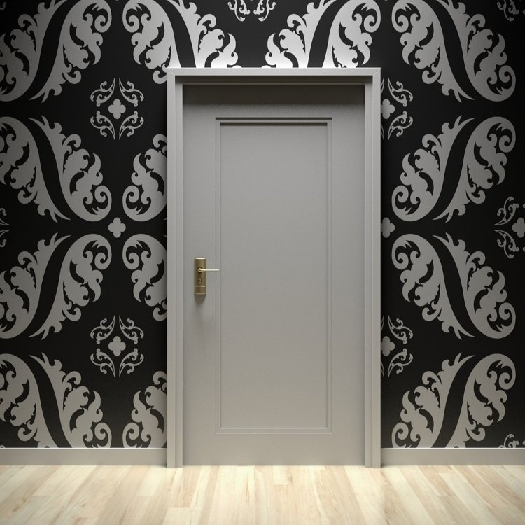 hall and landing ideas - white door set in wall covered in ornate black and white wall paper
