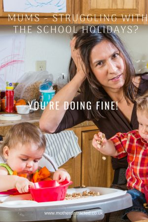parenting during the summer holidays - mum looking stressed in a kitchen with 2 children