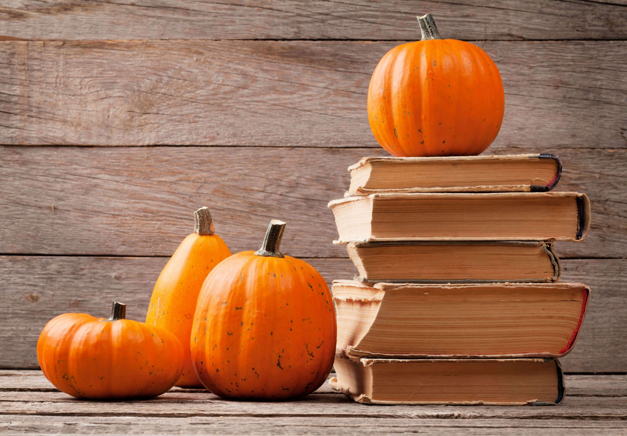 scary stories for halloween - pumpkins on a stack of ancient books
