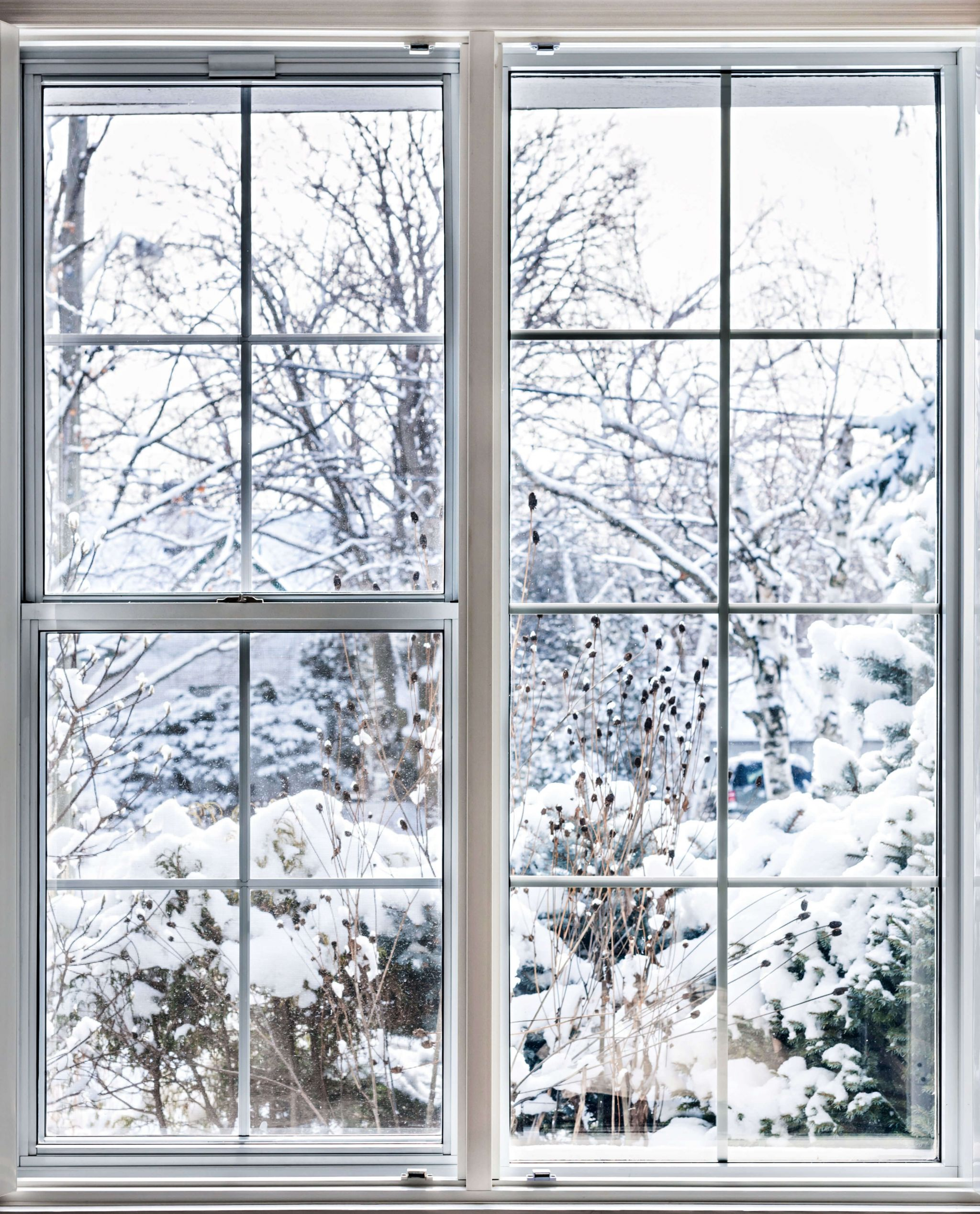 winter home improvements - snowy scene through a white window