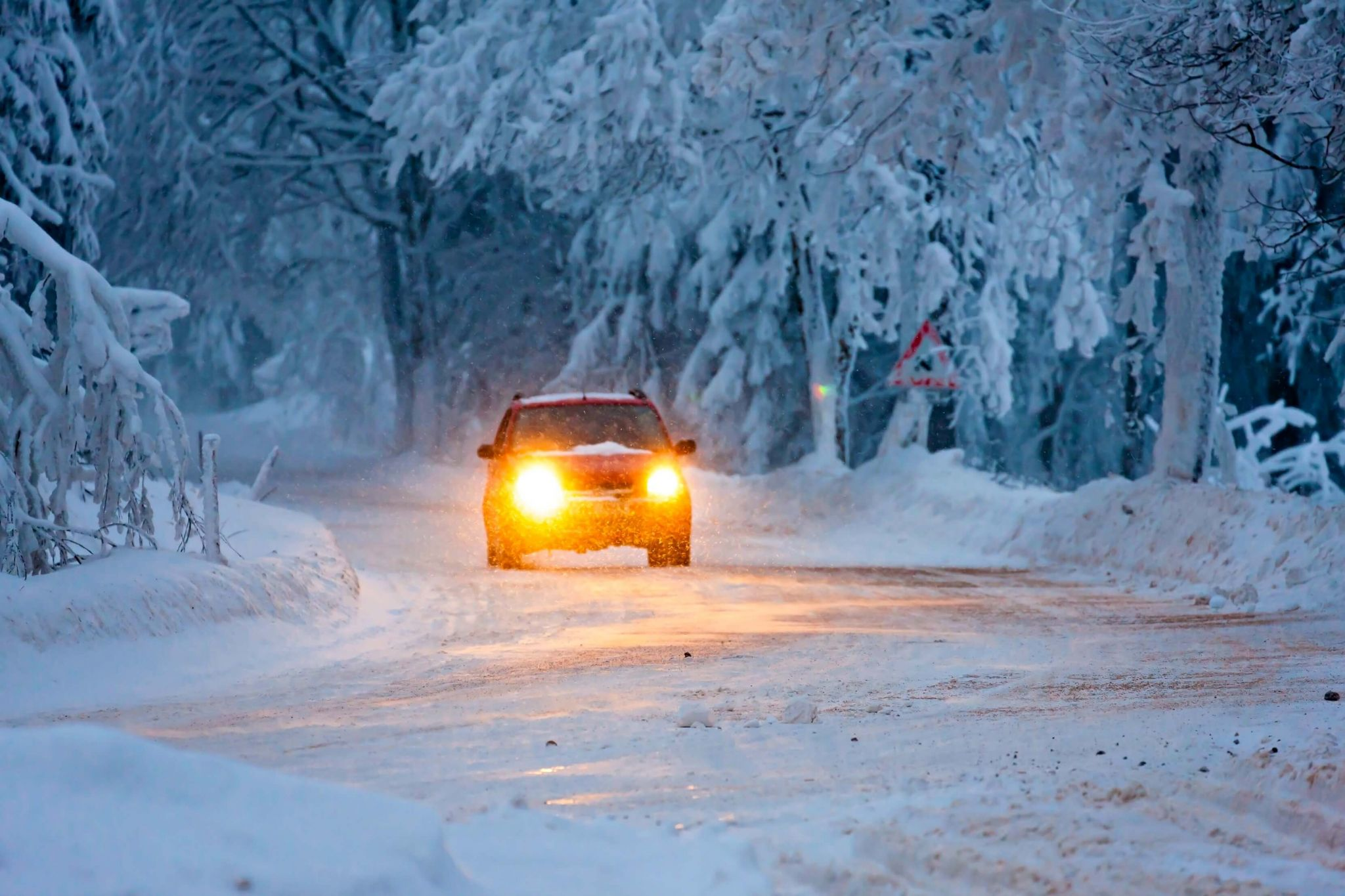 winter maintenance package - a car driving in a snowy forest