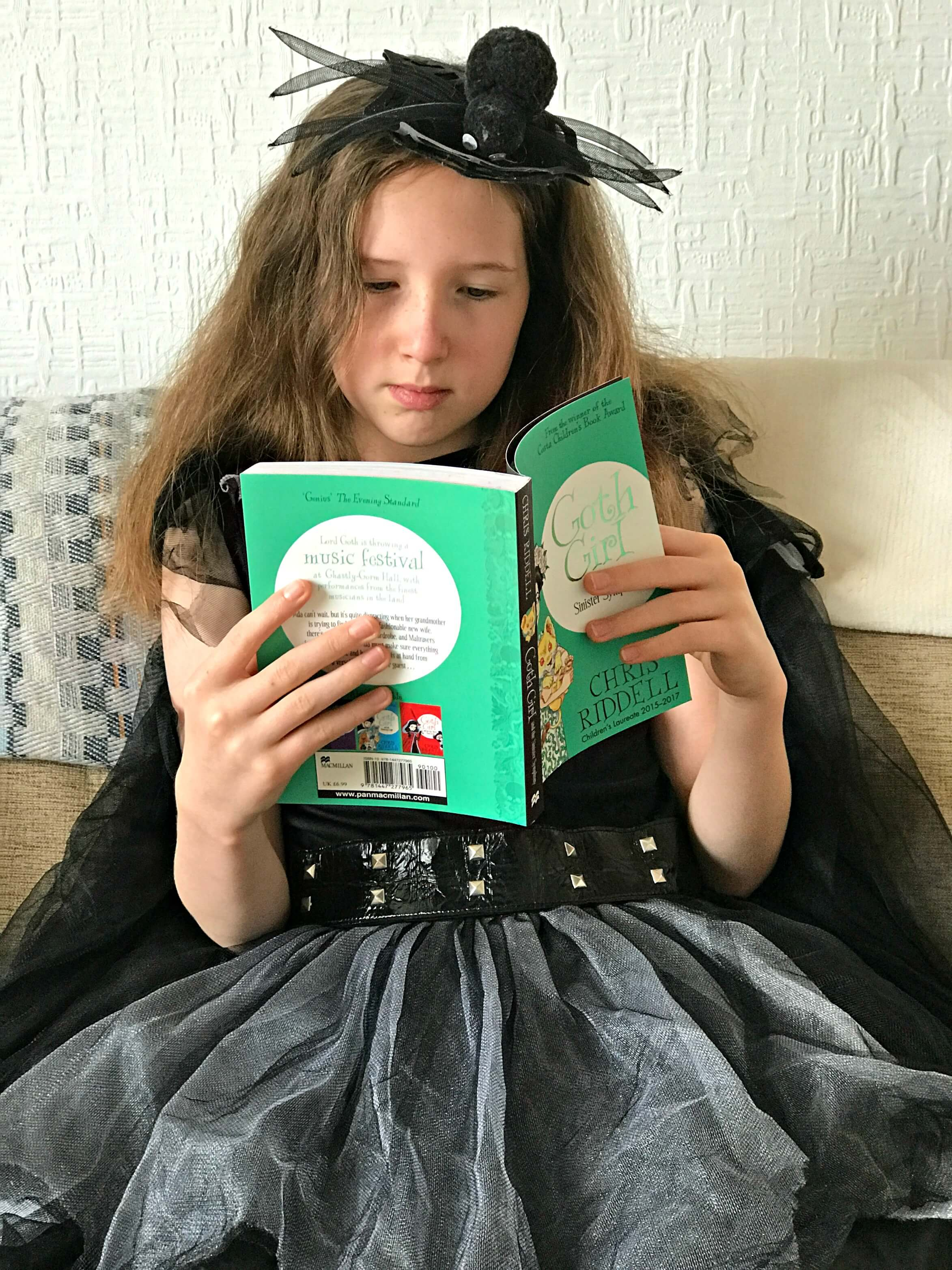 Caitlin, my very own Goth Girl reading Goth Girl and the Sinister Symphony