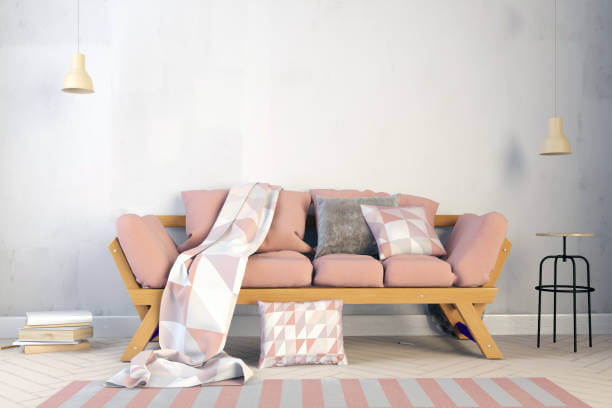 winter home improvements - wooden sofa with pink and grey cushions
