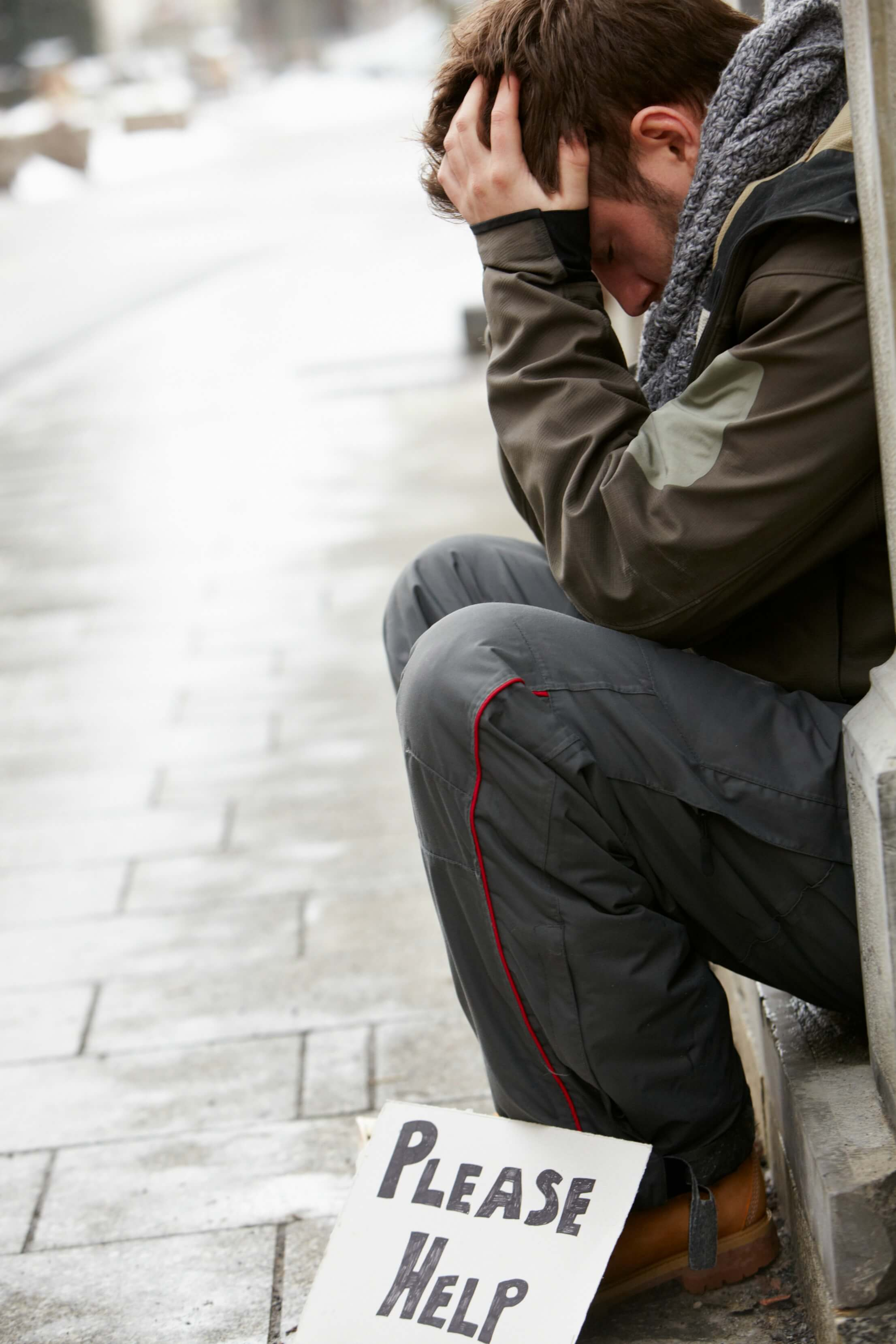 youth homelessness - a young man begging on the street