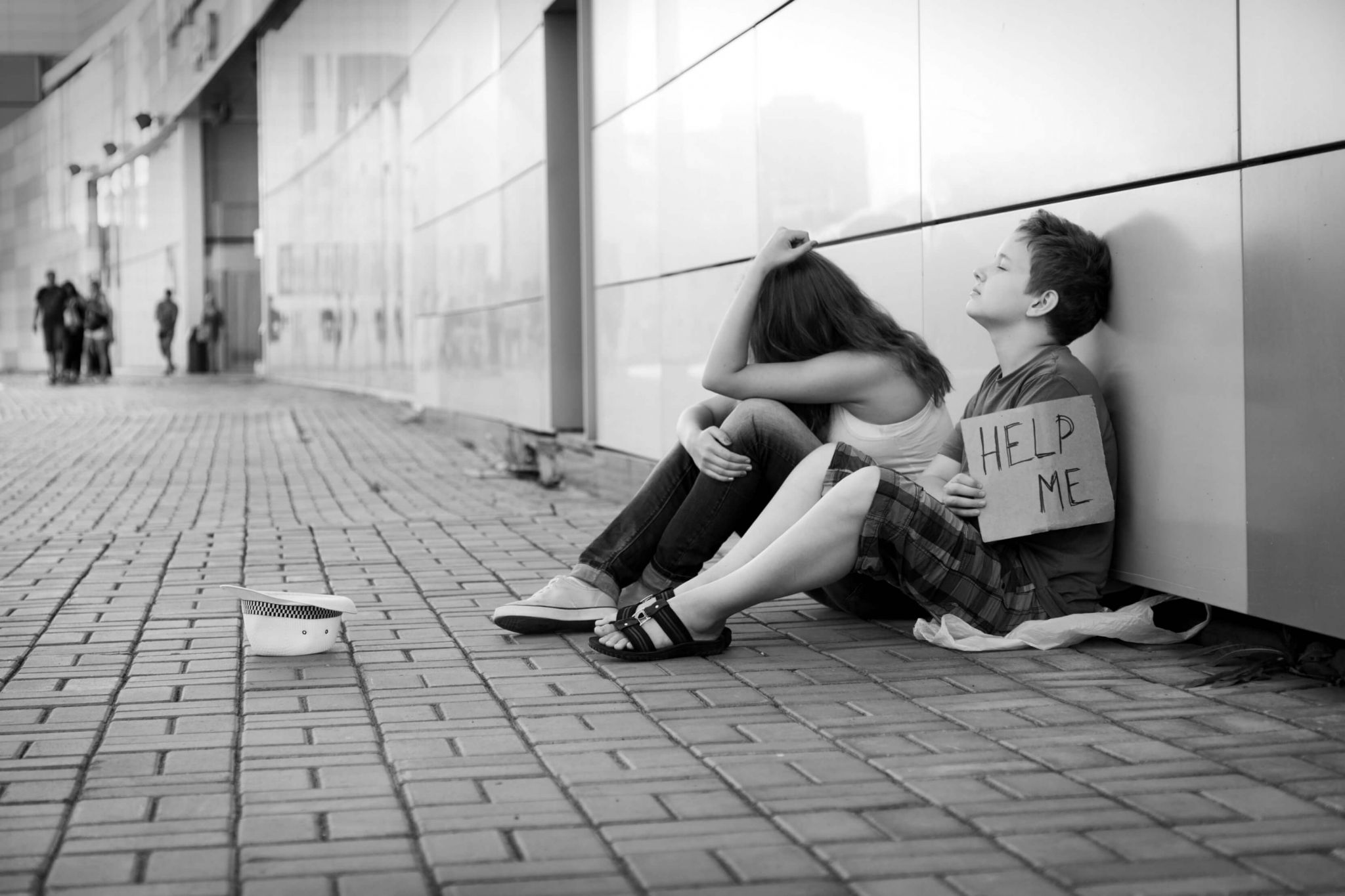 youth homelessness - young girl and boy begging on the streets
