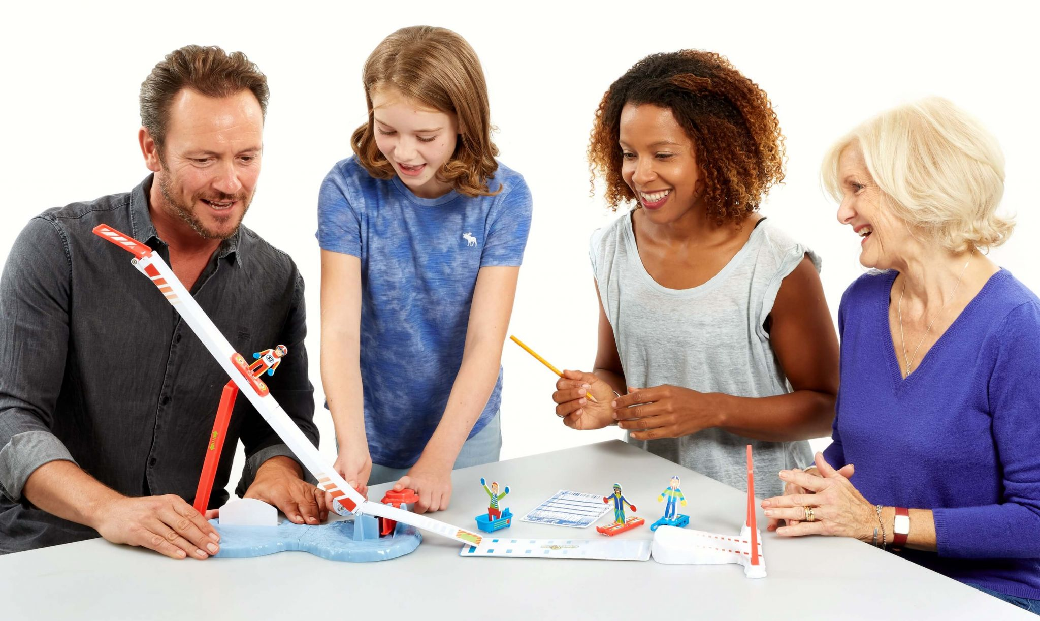 Family playing Super Ski Jump Tabletop Game From Drumond Park